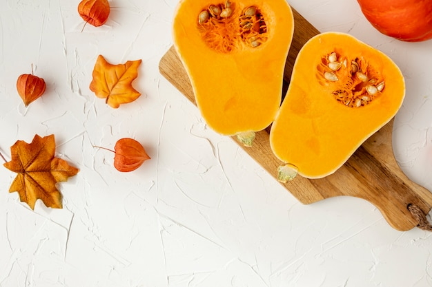 Halved pumpkin on cutting board