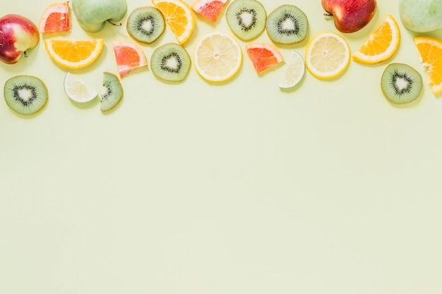 Halves of apples near cut fruits