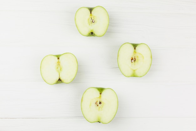 Halves apples on white background