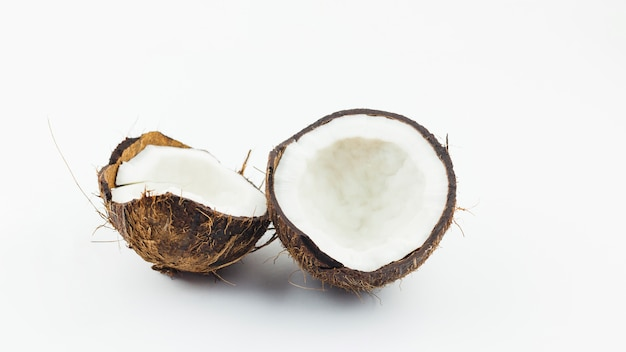 Halves of cracked coconut