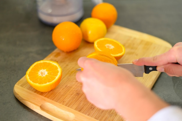 Halves of oranges and knife in the kitchen