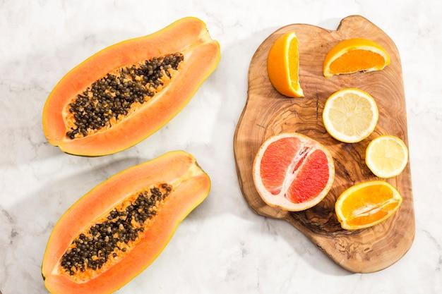 Halves of papaya and citrus fruits