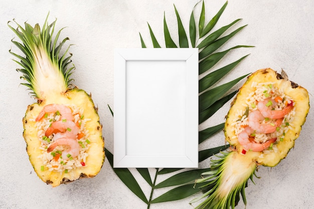 Halves of pineapple and copy space frame