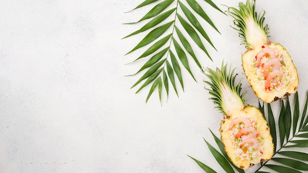 Halves of pineapple with copy space and leaves