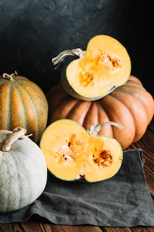Halves of ripe pumpkin on a black cloth