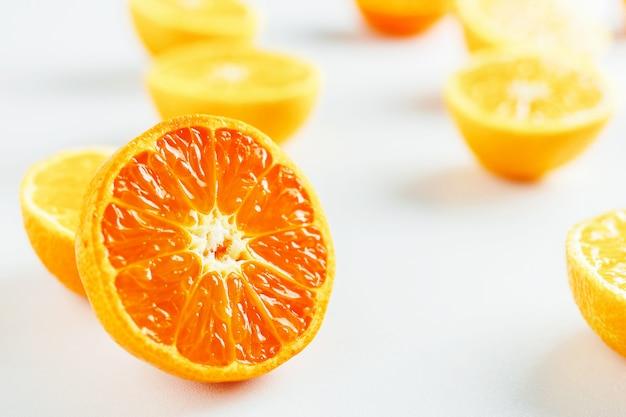 Halves of tangerines on white
