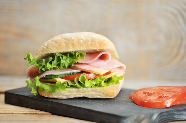 Ham and cheese sandwich on wooden board
