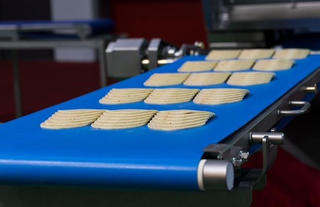 Ham on conveyor belt