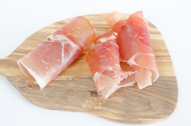Ham on olive wood board
