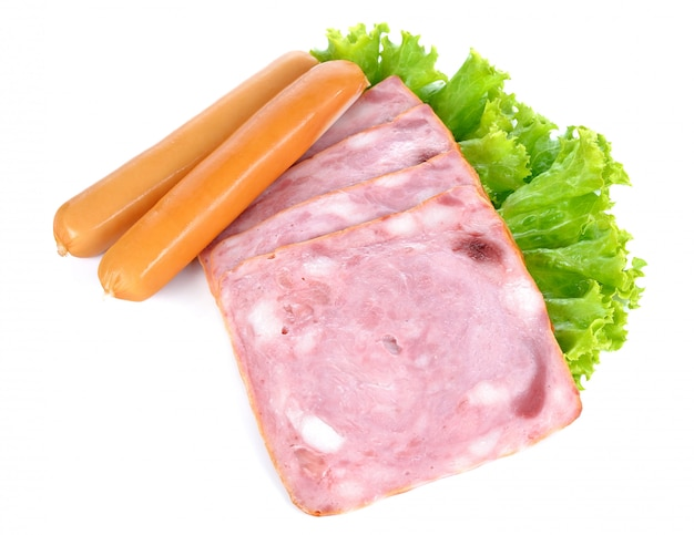 Ham and sausages isolated on white