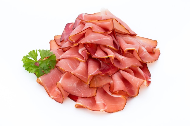 Ham sliced sausage isolated on white.