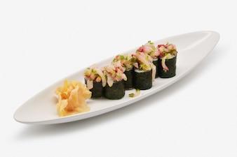 Hamachi negi Maki on white plate and white background