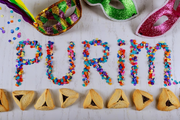 Hamantaschen cookies and carnival mask purim celebration