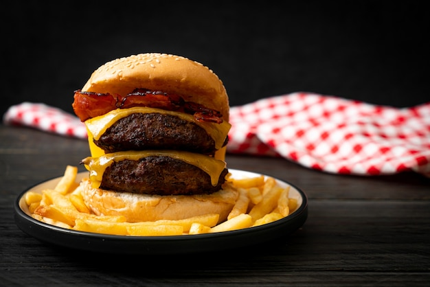 Hamburger or beef burgers with cheese and bacon - unhealthy food style
