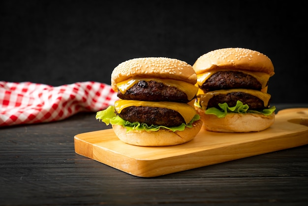 Hamburger or beef burgers with cheese. unhealthy food style
