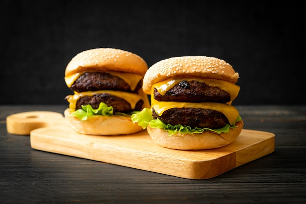 Hamburger or beef burgers with cheese - unhealthy food style