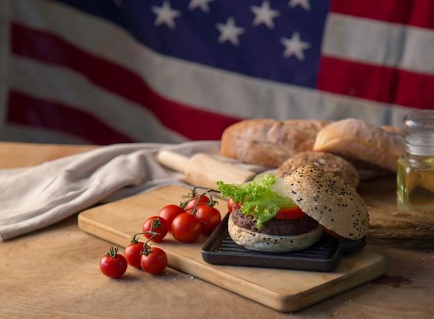 Hamburger homemade on wood table.