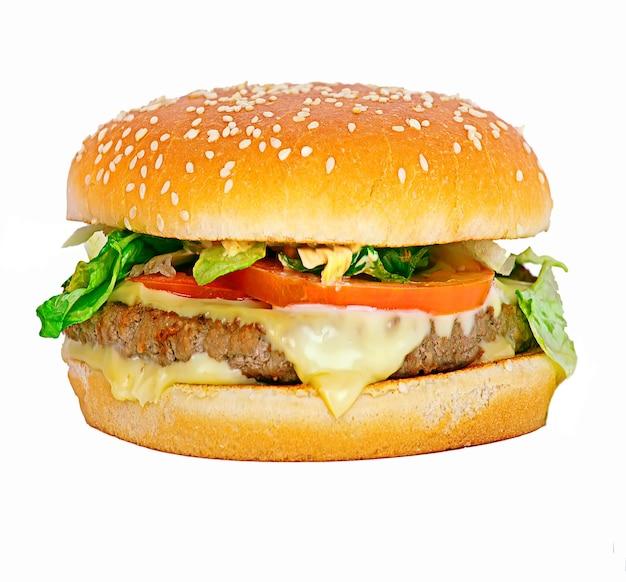 白いファーストフードのジャンクフードに分離されたハンバーガー
