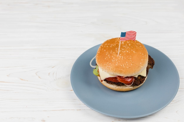 Hamburger on plate with flag
