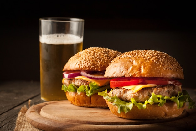 Hamburger with beef, onion, tomato, lettuce and cheese.