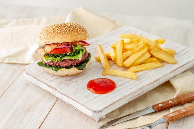 Hamburger with fries and sauce