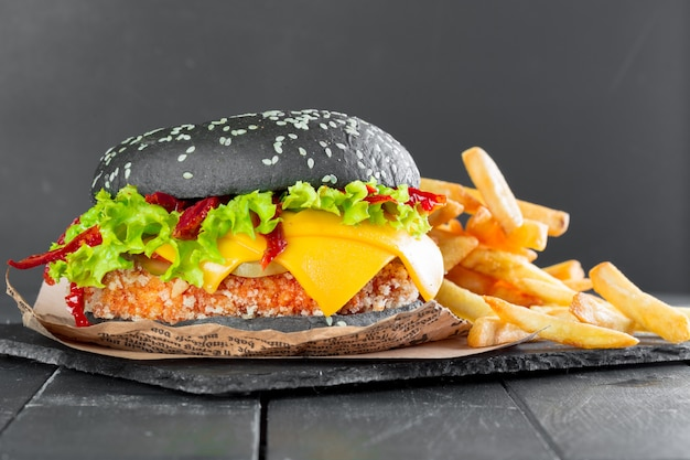 Hamburger with fries on a slate plate