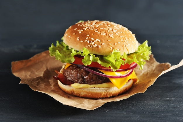 Hamburger with onion tomato and salad
