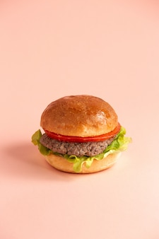 Hamburger with tomato lettuce leaf and beef patties in burger buns