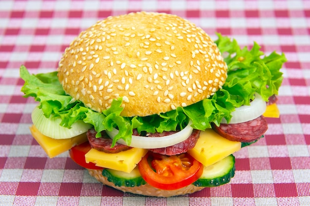 Hamburger with vegetables and sausage. fast food and breakfast. calories and diet.