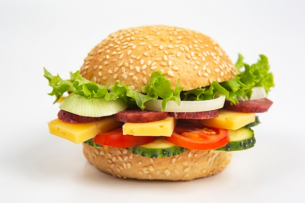 Hamburger with vegetables and sausage. fast food and breakfast.