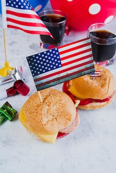 Hamburgers cola party horns and american flags