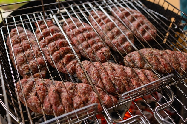 Hamburgers cooking on the grill, copy space.