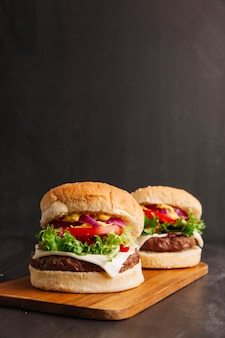 Hamburgers on wooden board