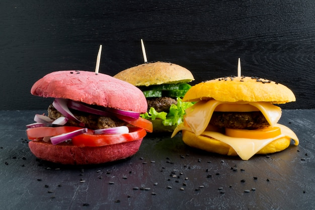 Hamburgers with colored buns.