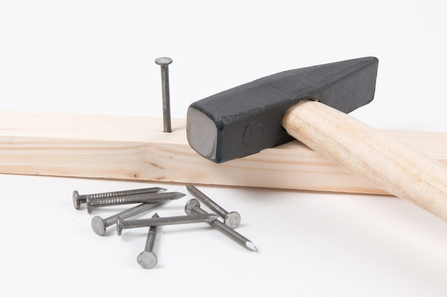 Hammer and building nails on white.
