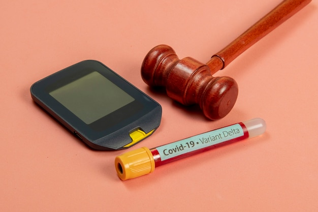 Hammer of justice associated with medicine, symbolizing legal means of getting treatment