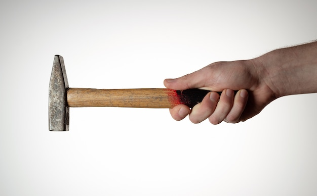 Hammer in mans haond on white background.