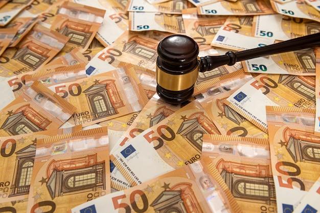 Hammer and many 50 euro bills
