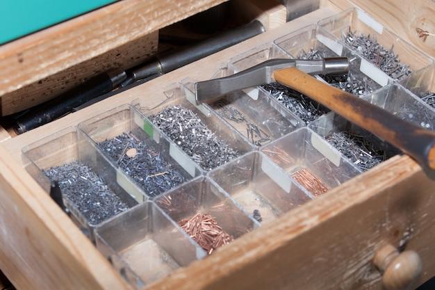 Hammer and nails shoemaker