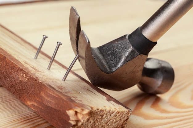 Hammer and nails on wood