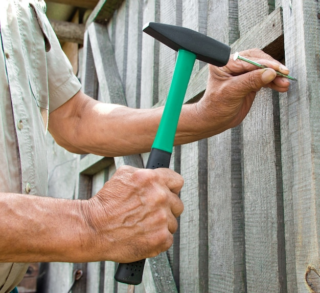 Hammering a nail with a hammer detail