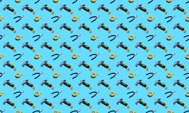 Hammers, pliers, and duct tape on a blue background, pattern, hard shadows. construction tools, repairs. background for the design.