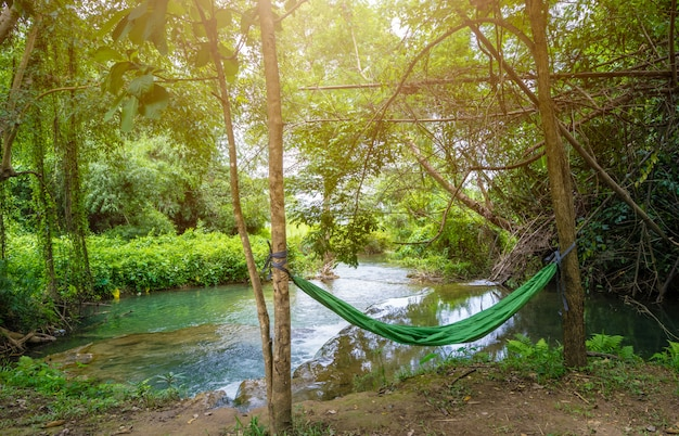 Hammock between two trees near the waterfall in campsite