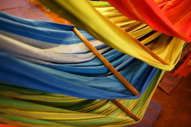 Hammocks of different colors, colors of the rainbow on the night market in goa