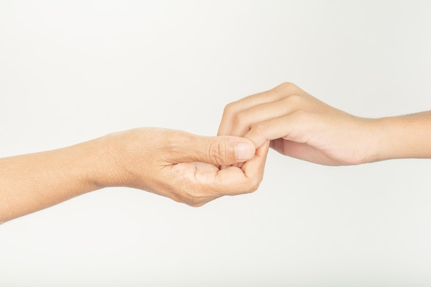 Hand 2 hands with different skin.