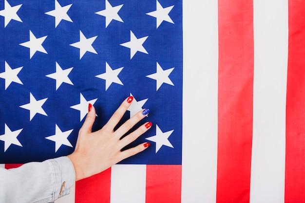 Hand on american flag
