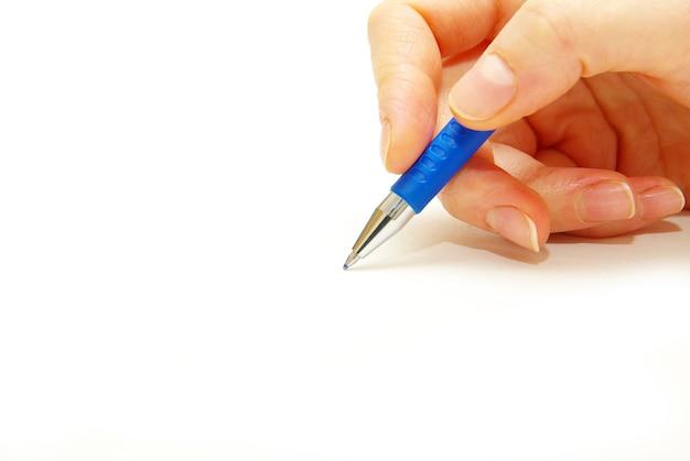 손과 흰색 바탕에 펜