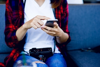 Hand and phone of the girl doing business online and business communication concept with copy space.
