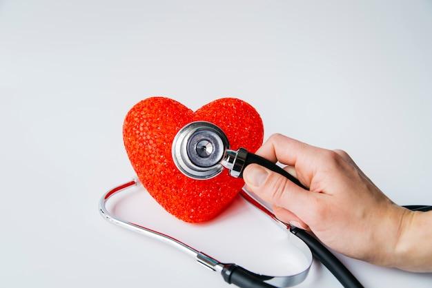 Hand auscultating heart