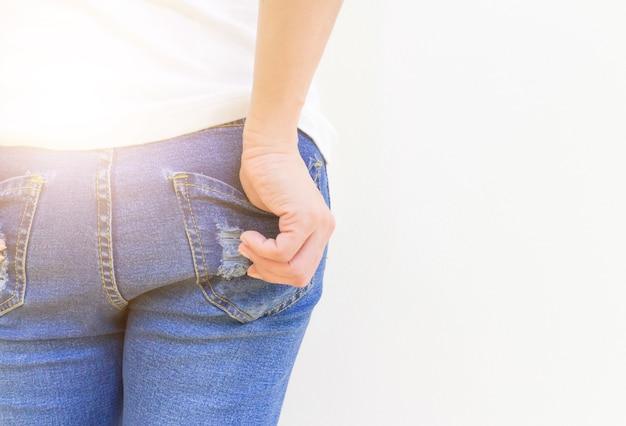 Hand back jeans pocket white background